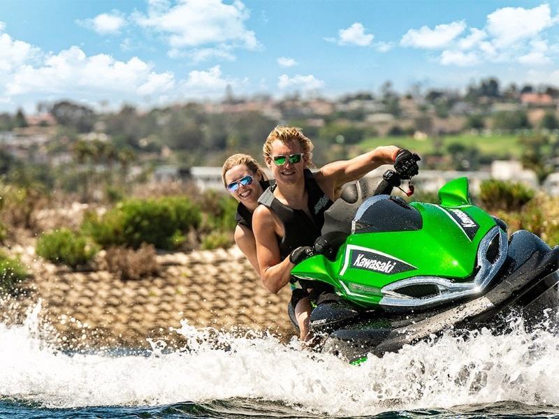 Man and woman with sunglasses riding a 2019 Kawasaki Jet Ski® Ultra® 310LX