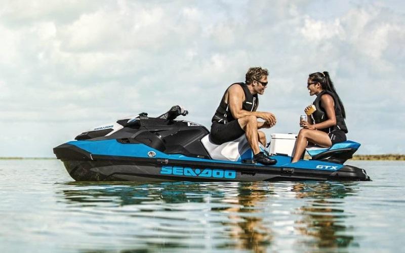 a couple taking a break on a 2019 Sea-Doo GTX 155 Rotax®