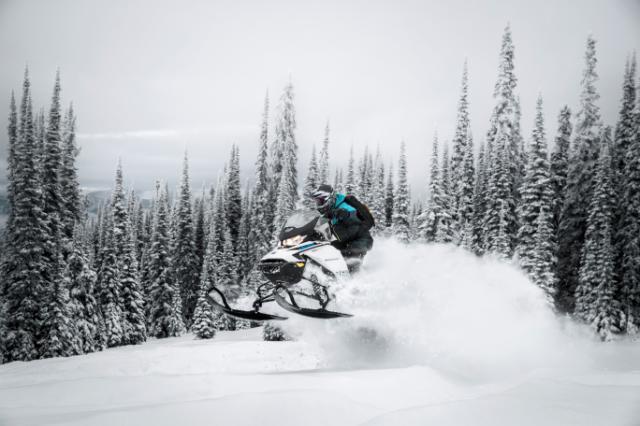 Snowmobile jumping through the snow
