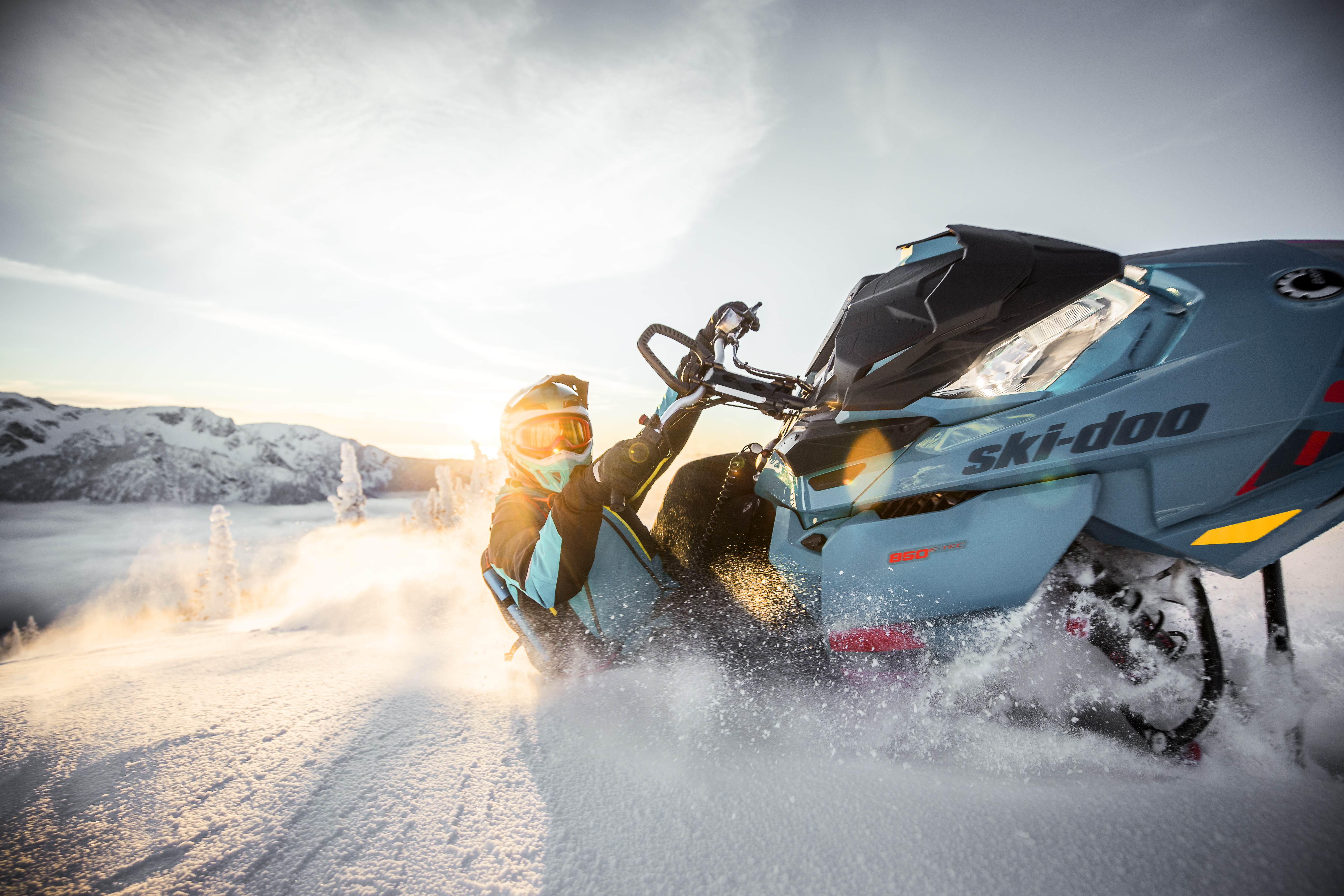 Leaning into the turn on a Ski-Doo snowmobile