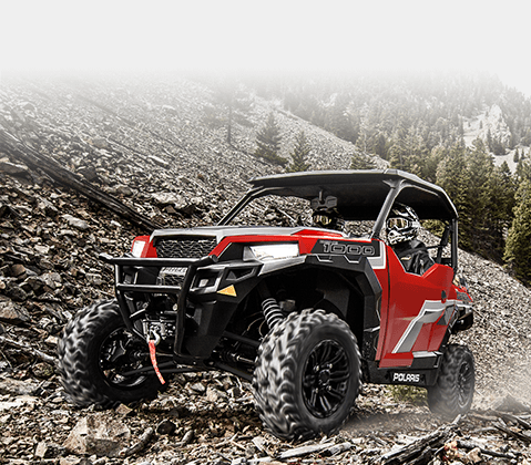 Polaris® SxS taking a trail up past the tree line.