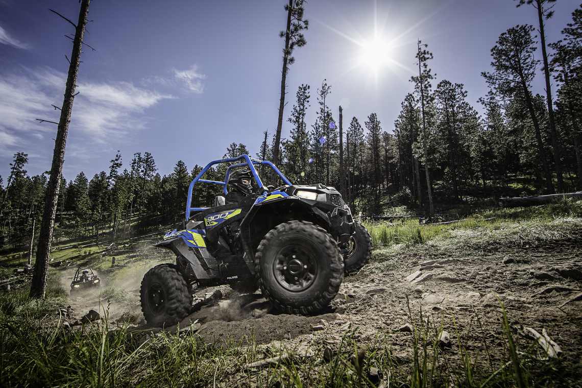 2018 Polaris Ace 900 climbing dusty trail