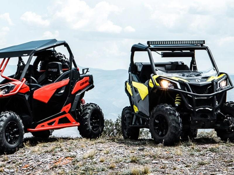 Two Can-Am UTVs on a hill