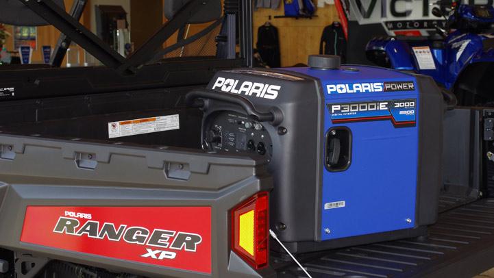 Polaris Generator sitting in the back of a UTV