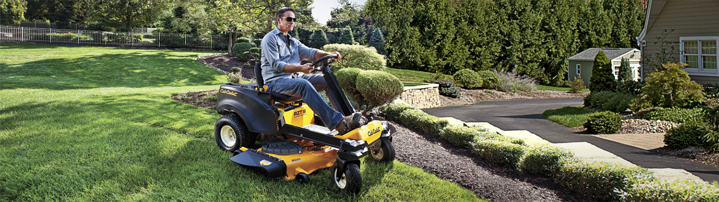 Man on a Cub Cadet riding mower