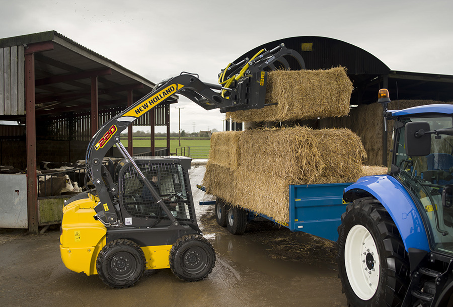 Skid Steer Loader loading bails of hay