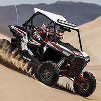 Polaris® Side by side on sand dune