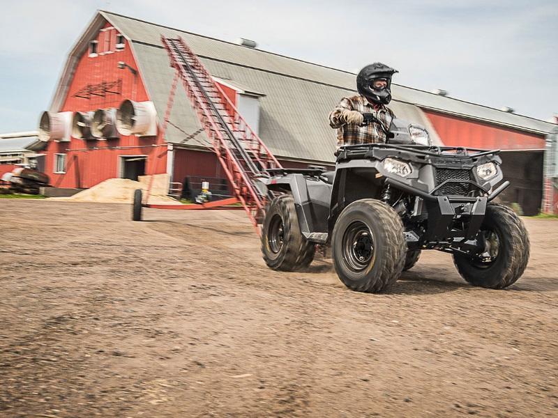2019 Polaris® Sportsman® 450 Utility Edition ATV driving on farm