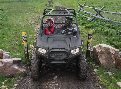 two persons on a 2019 Polaris Industries RZR® 570 EPS side by side