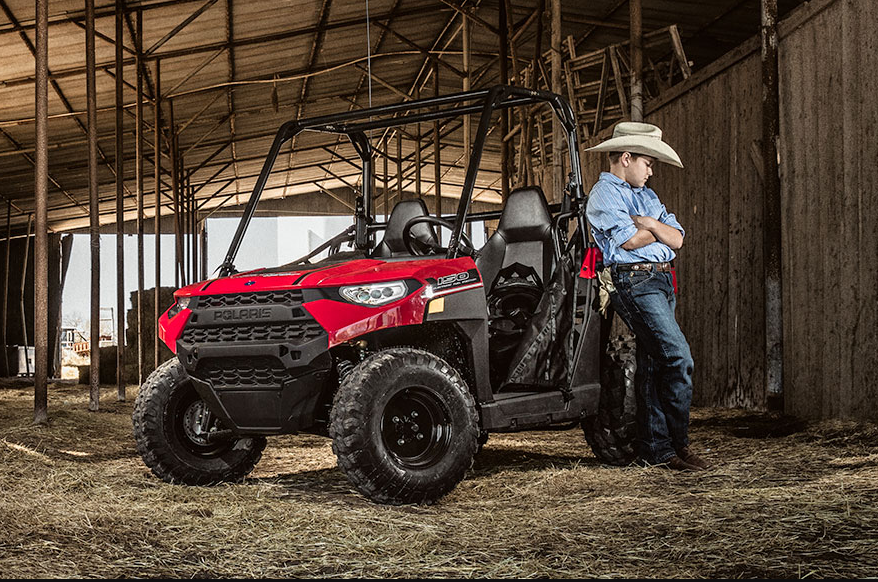 Small Cowboy with Polaris® 150 EFI Ranger Side x Side