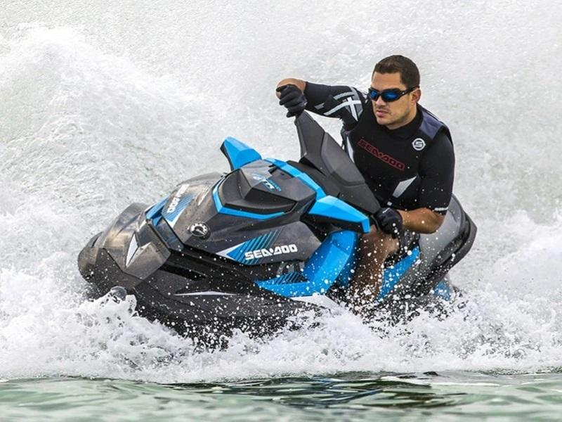 Man riding on a 2019 Sea-Doo GTR 230 quickly