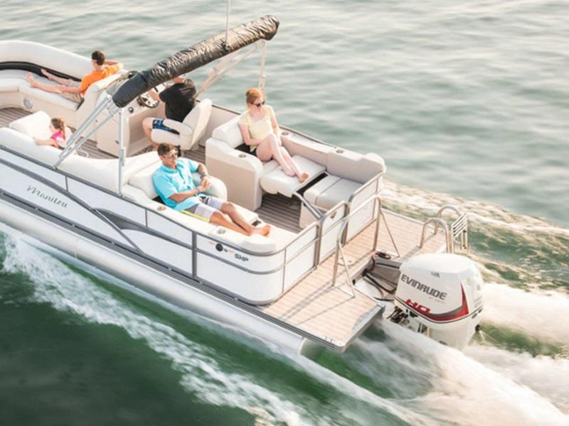 Family enjoying the water on a pontoon using an Evinrude Outboard Motor