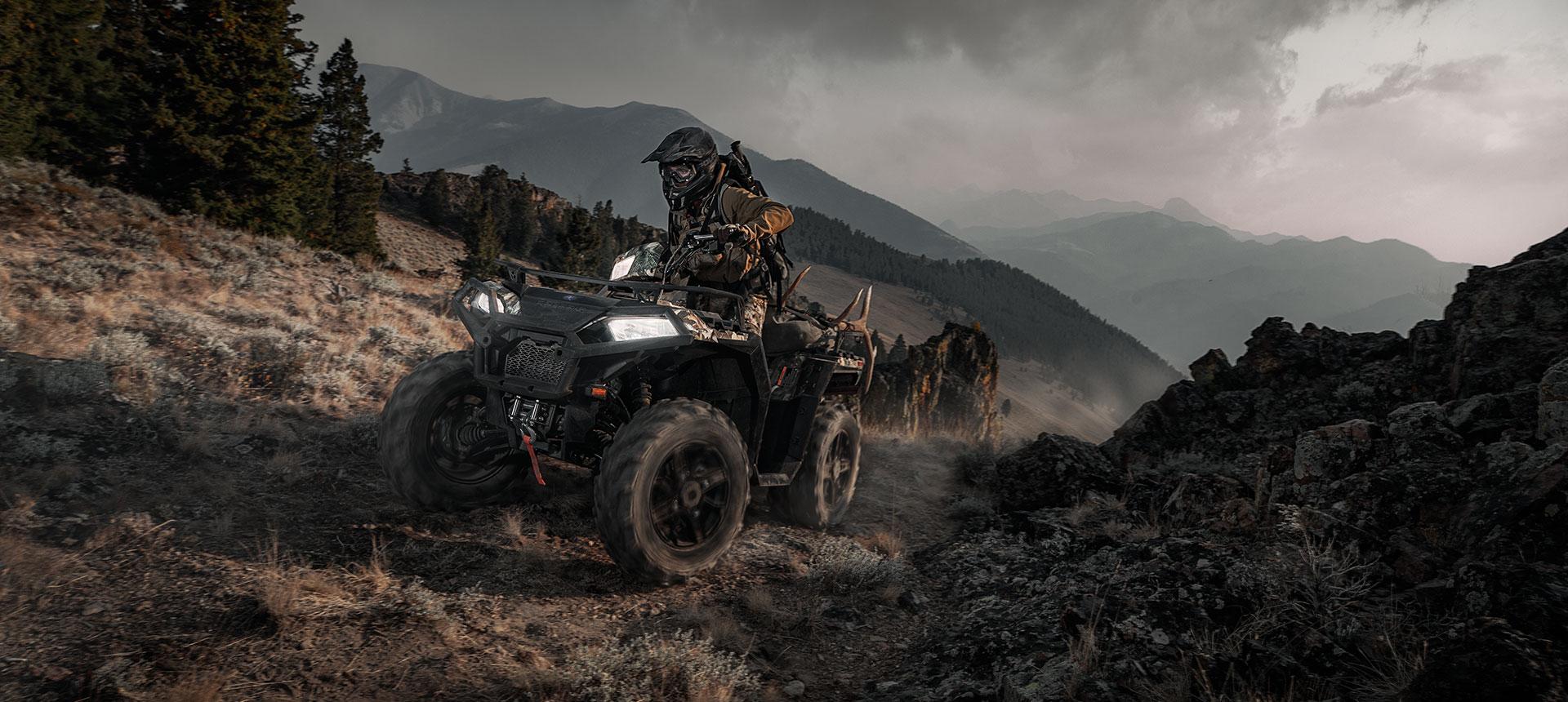 Polaris ATV going up a trail