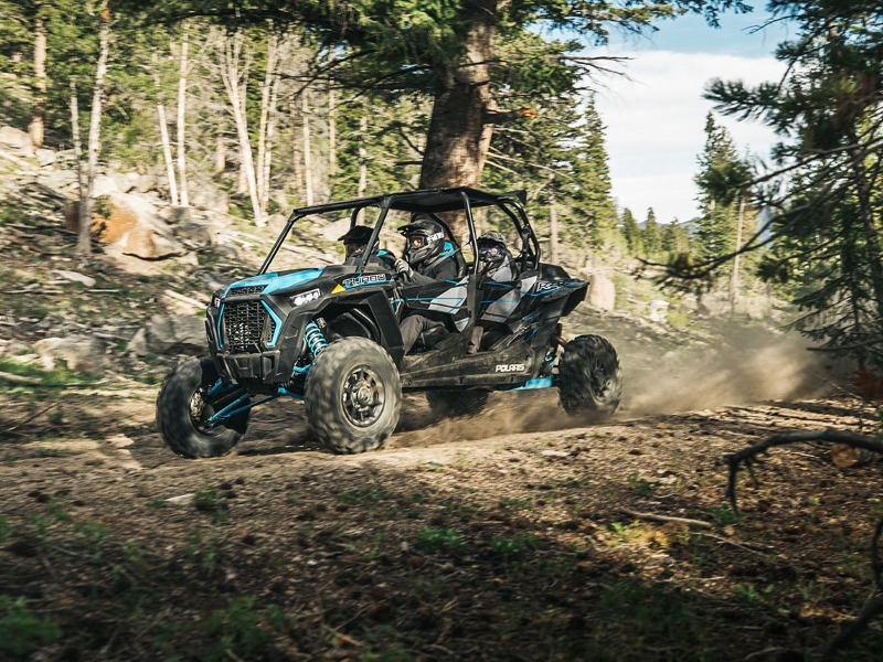 Polaris® RZR tearing along a woodland trail