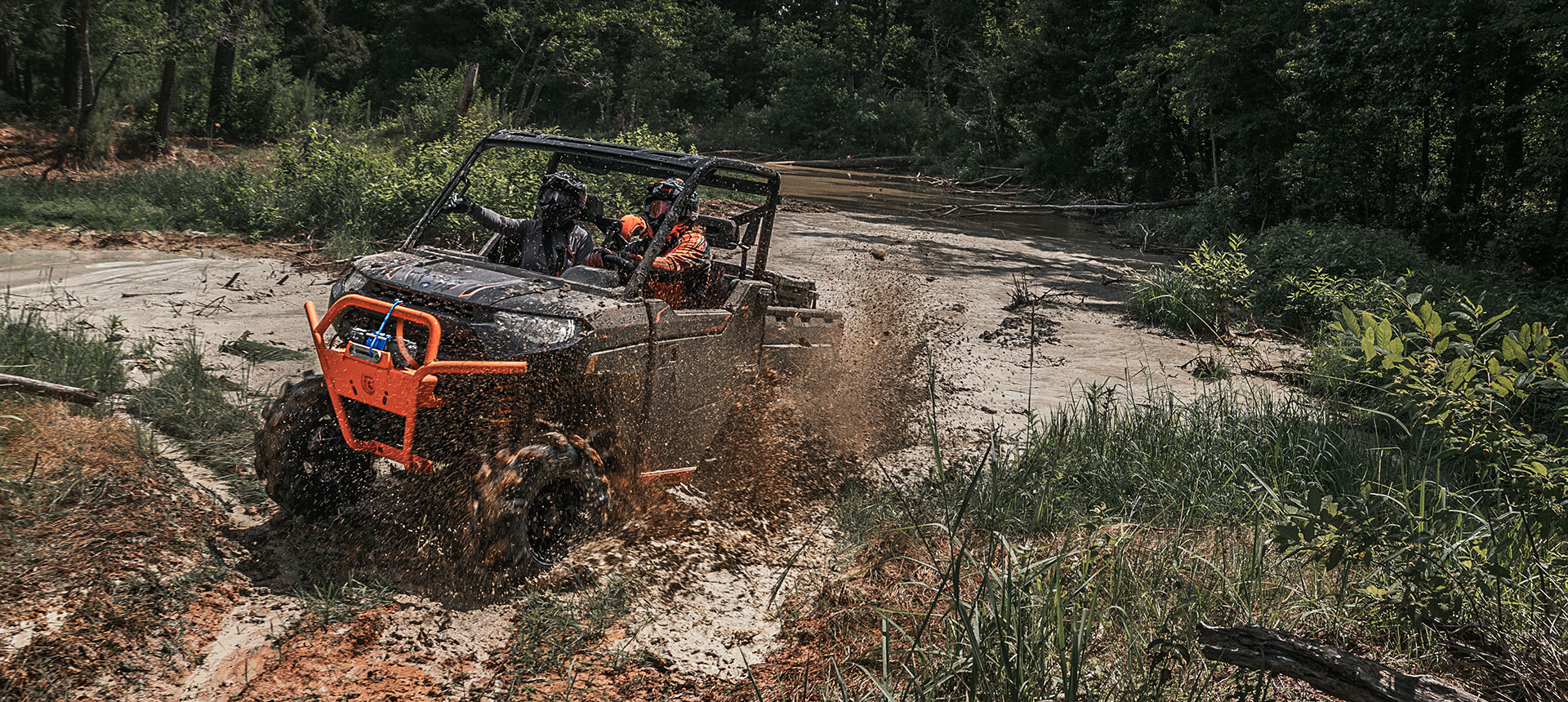 Polaris UTV getting dirty in the mud