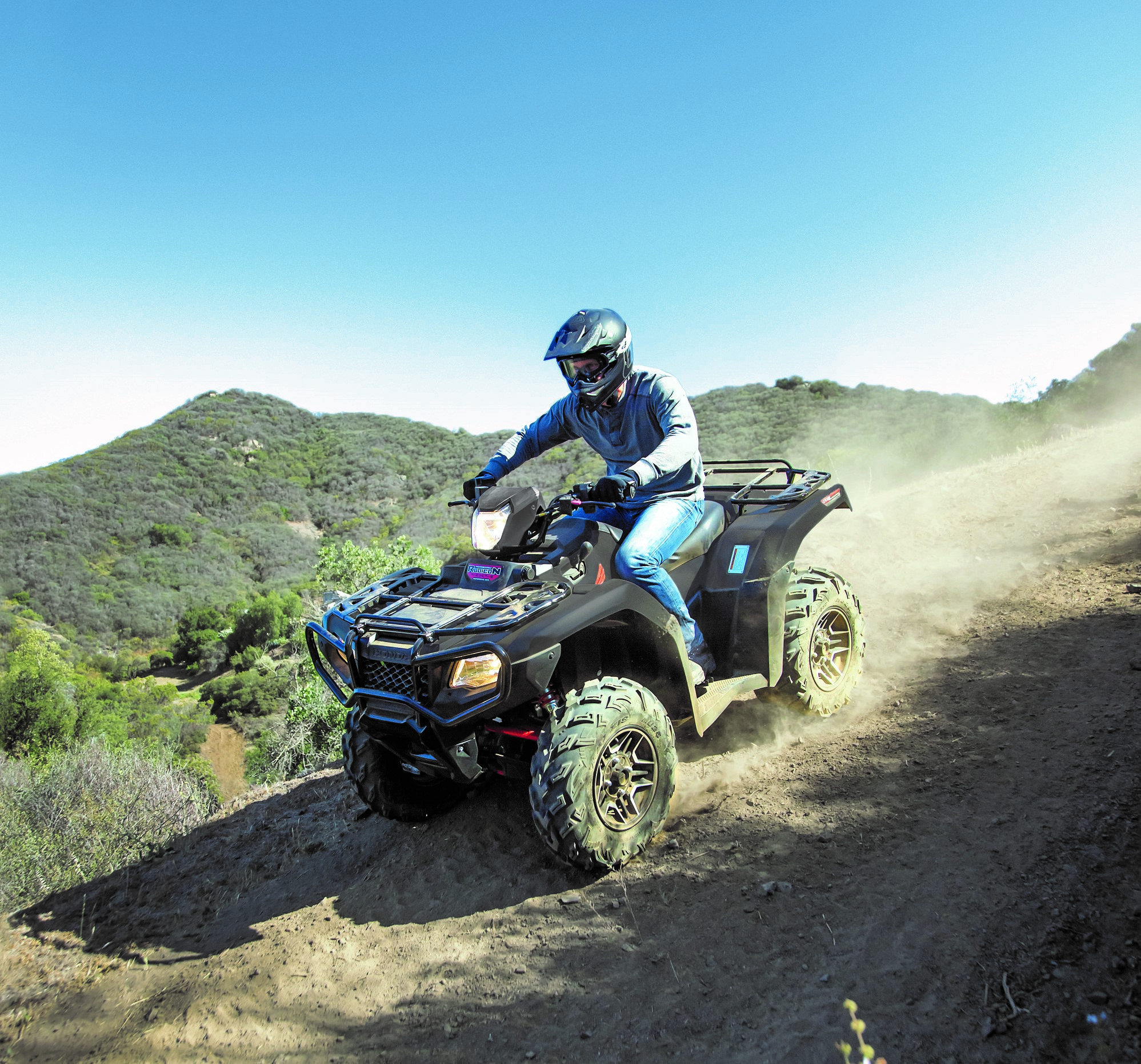 Honda ATV on a dirt trail.