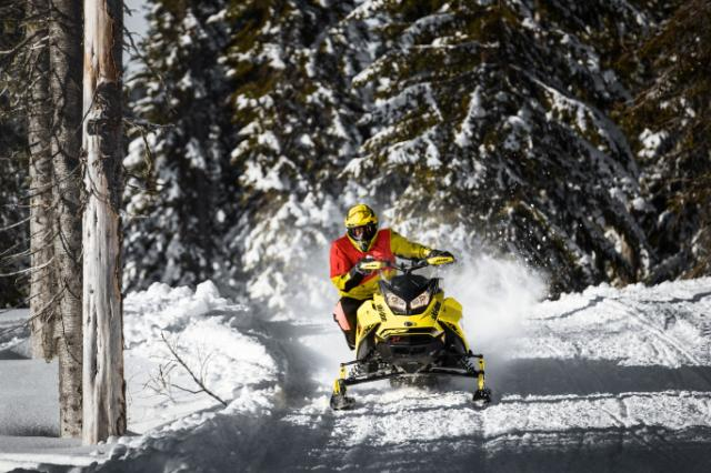 Man jumping Ski-Doo snowmobile in the snow