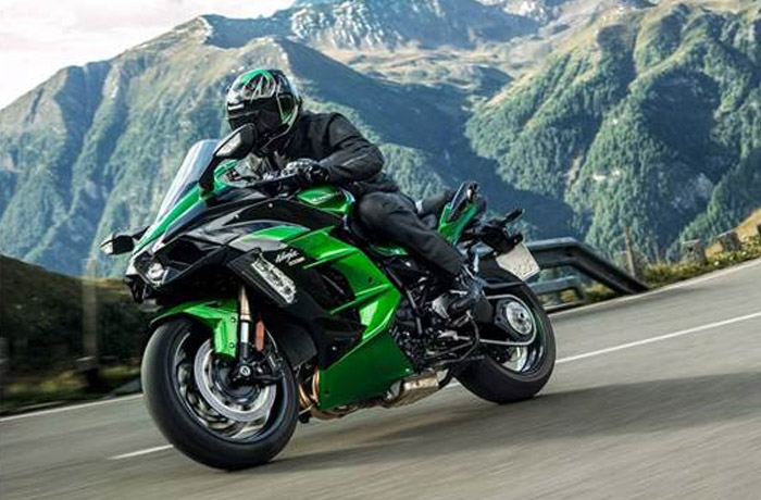 Kawasaki Ninja moving fast with mountains in the background
