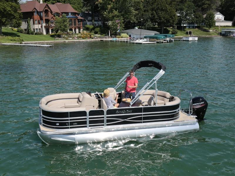 Husband and wife having lunch on a 2017 South Bay Pontoon 217CR