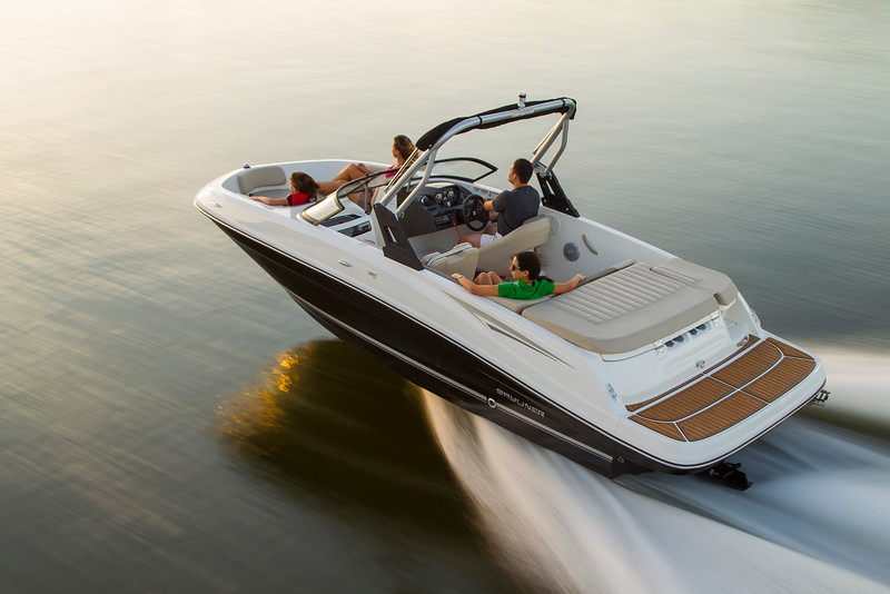 Taking a fast cruise in a bow rider on still water