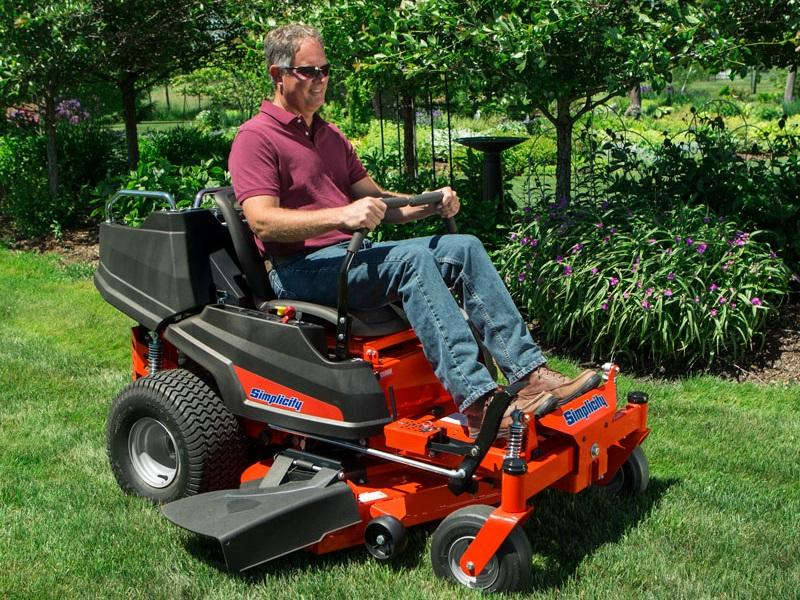 Man using his Simplicity riding zero turn mower to cut his grass to the perfect height
