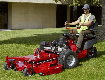 a man using a 2019 Ferris ProCut™ S 5900533 lawnmower