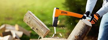 Man chopping wood with a STIHL hand axe.