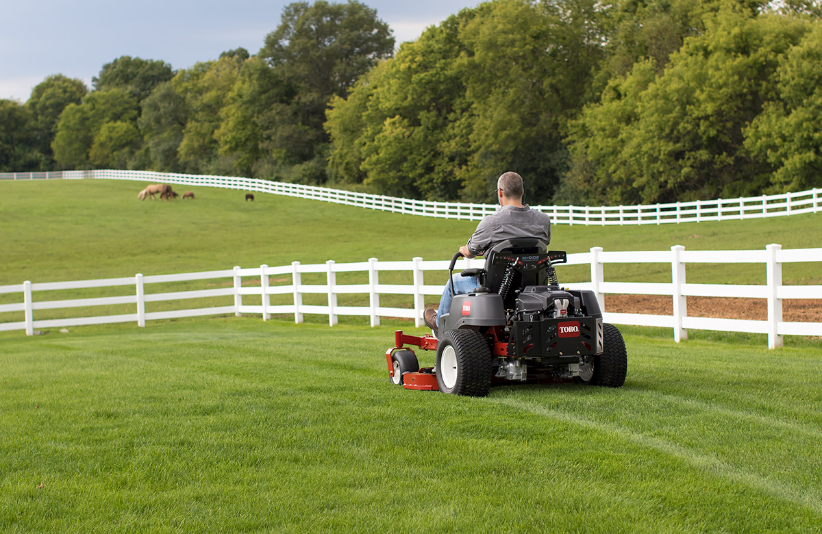 Man mowing a field of grass