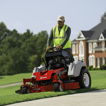Mowing the yard with a commercial zero turn mower.