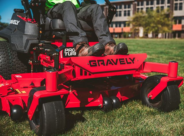 Gravely riding mower cutting the grass