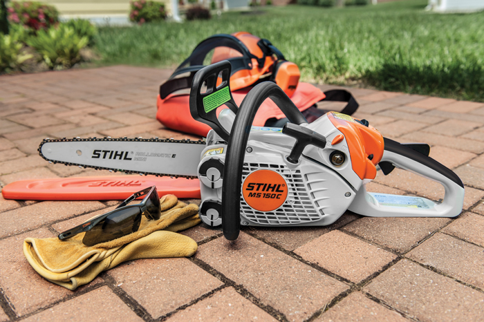 STIHL chainsaw sitting on the ground