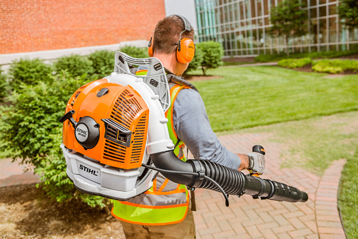 Using a STIHL backpack blower to clear a walkway