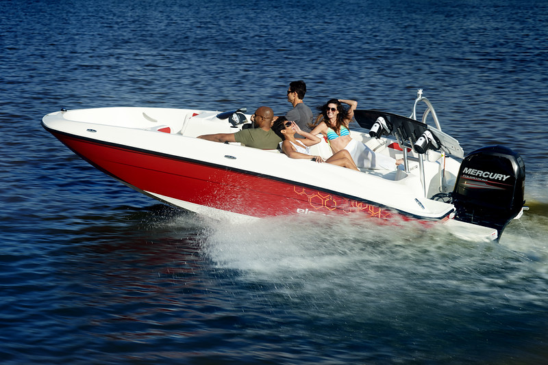 Four people on a Bayliner boat on the water.