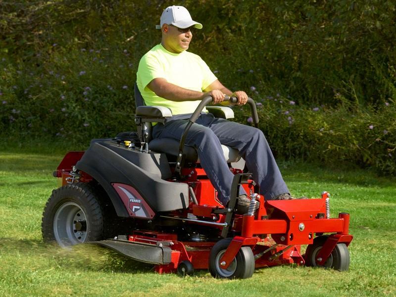 Man mowing lawn on a ferris lawn mower