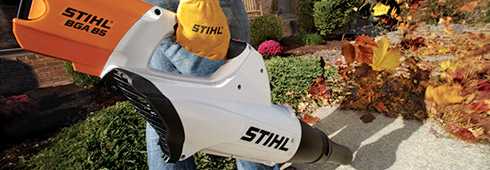 Man using a STIHL® blower to clear leaves in the Fall