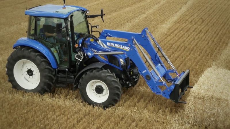 2019 New Holland Ag Tractor Moving Hay Bale