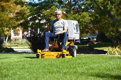 Man on a Walker commercial riding lawn mower.