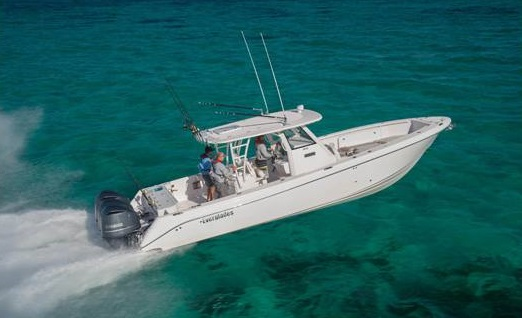 Three persons on a 2016 Everglades Boat 355CC