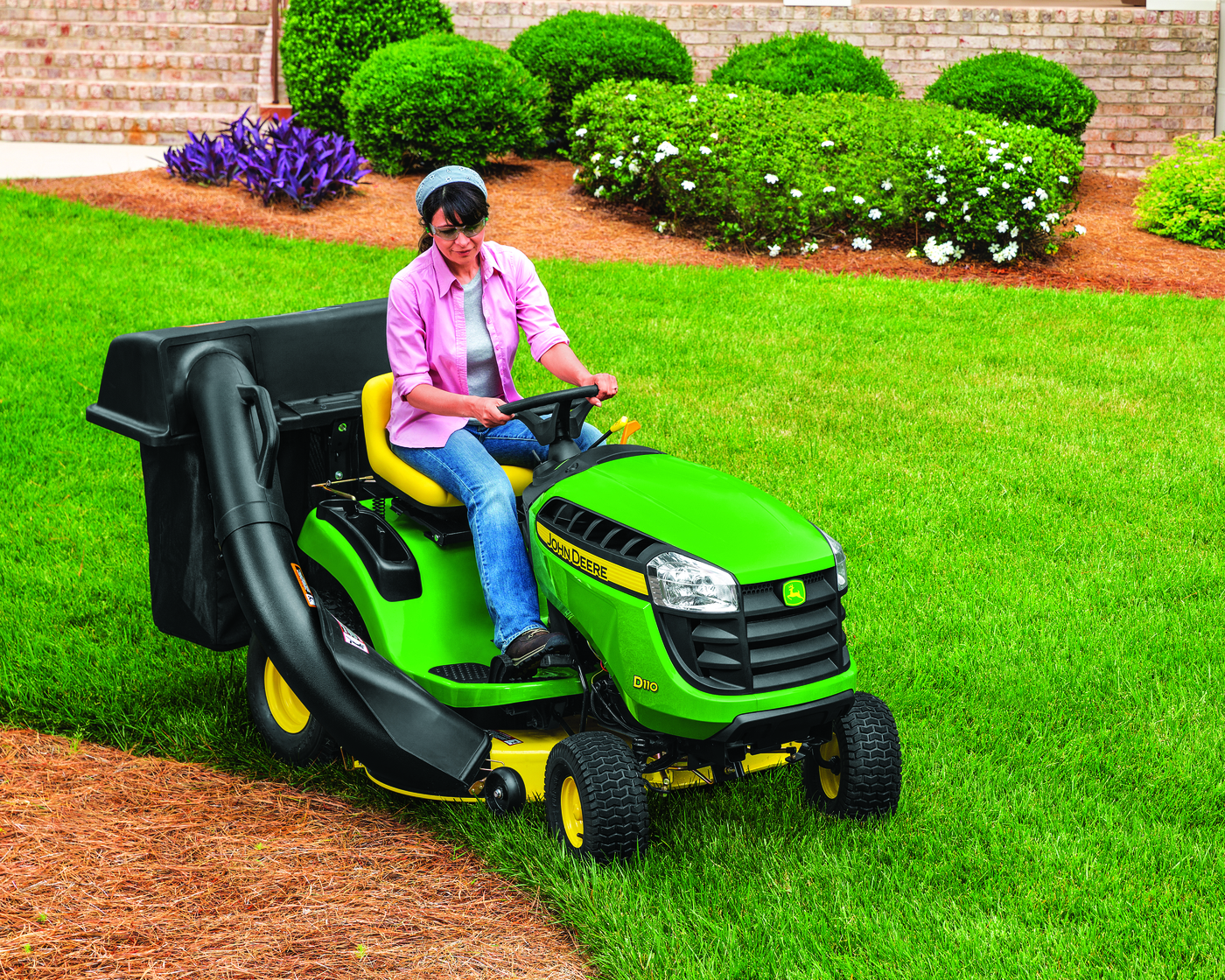 Woman Riding John Deere D110 Lawn Tactor