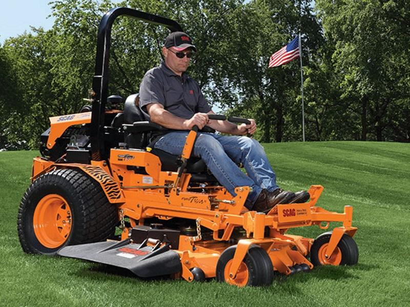 Man using a Scag Power Equipment Zero turn mower to mow