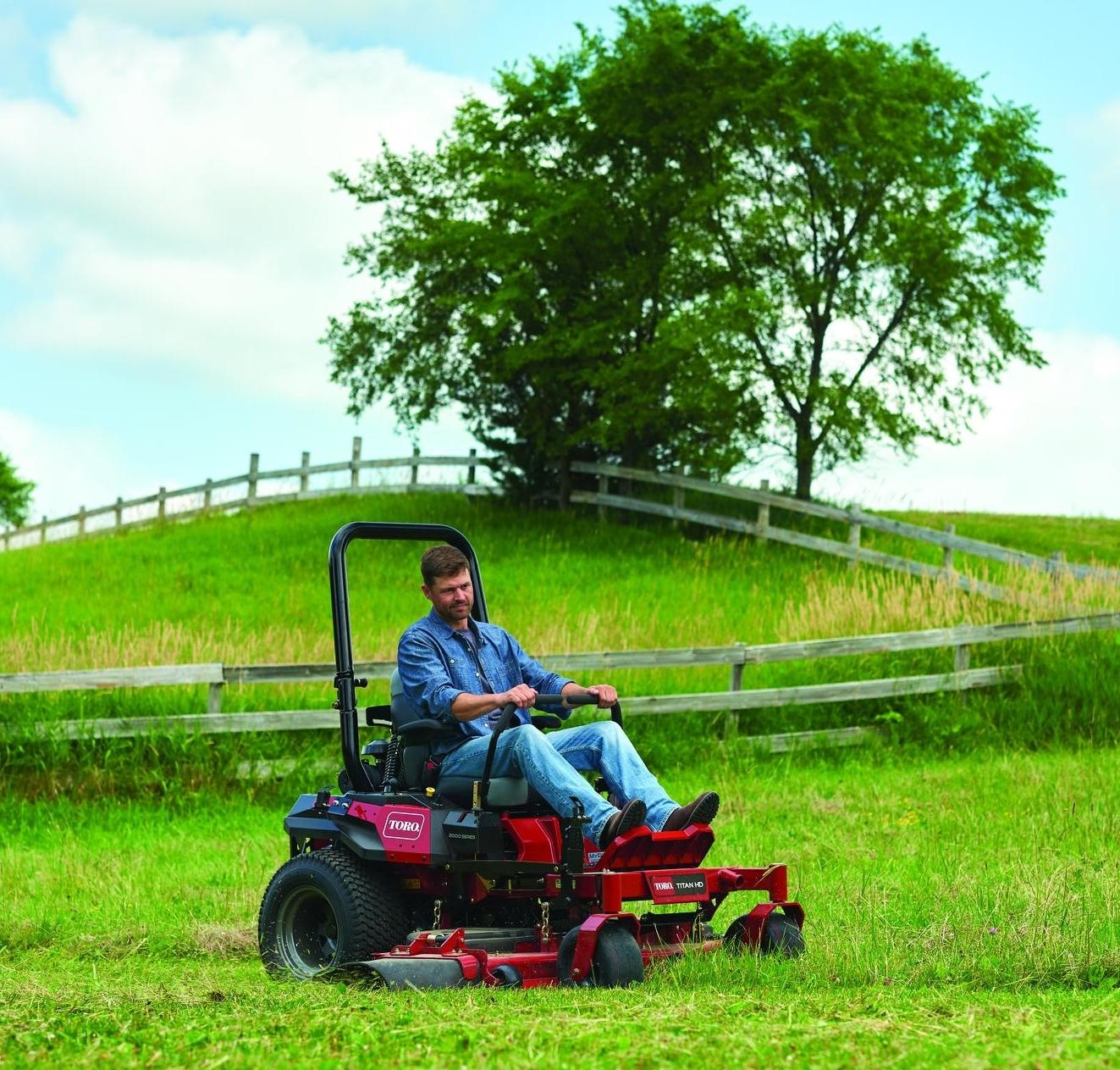 2019 Toro® Titan® zero turn mower cutting grass in gated field