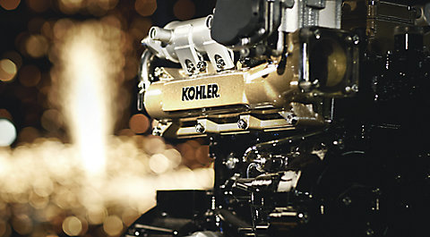 KOHLER engine with sparks shooting off in the background.