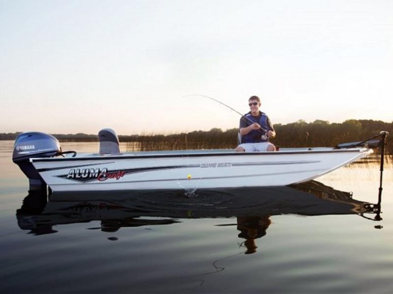 Man fishing in a lake enjoying the water while using an Alumacraft fishing boat