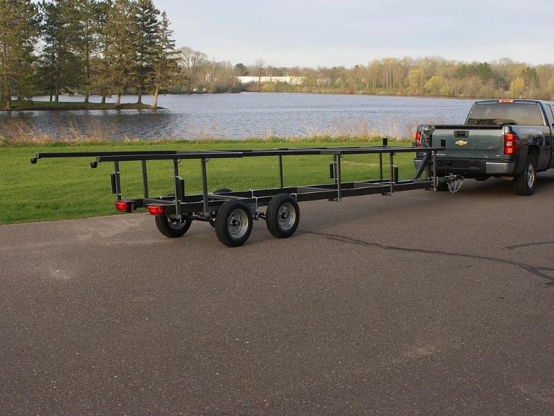 Truck pulling a 2019 Trophy Trailers Pontoon STD 18 pontoon trailer to the lake to pick up a pontoon