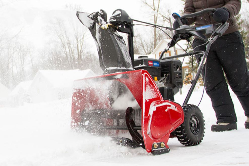 Toro Snowthrower being used in the yard