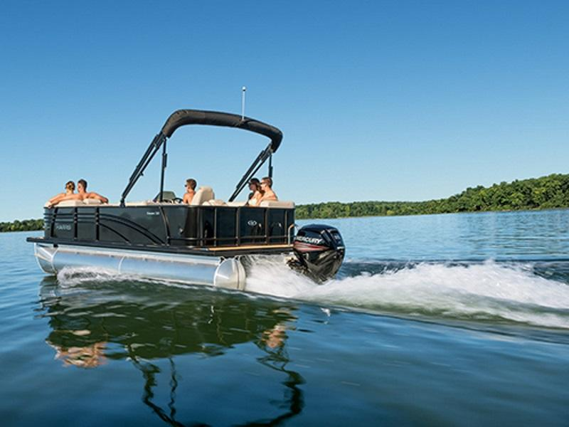 Family riding a 2019 Harris Sunliner 230 CWDH pontoon on the water