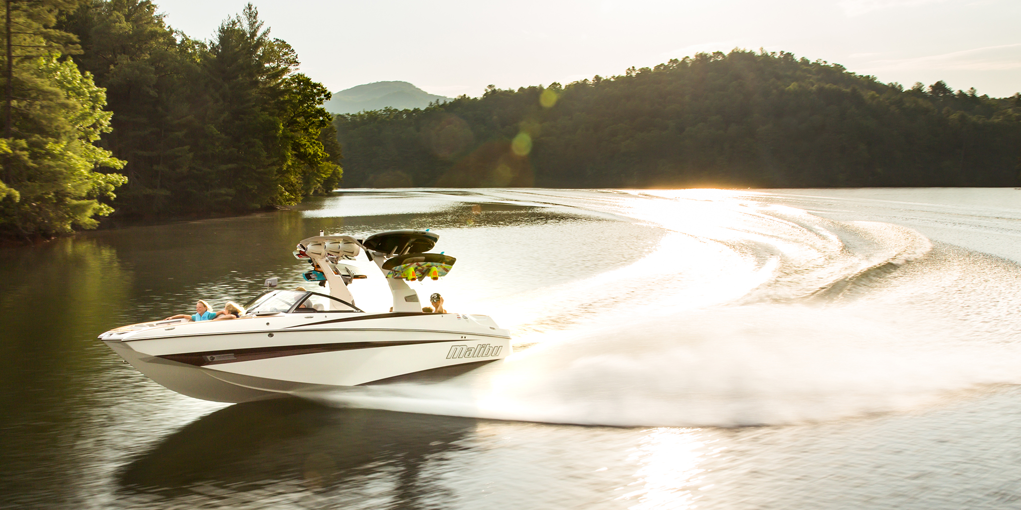 Getting a wakeboard boat up to speed after taking a smooth corner