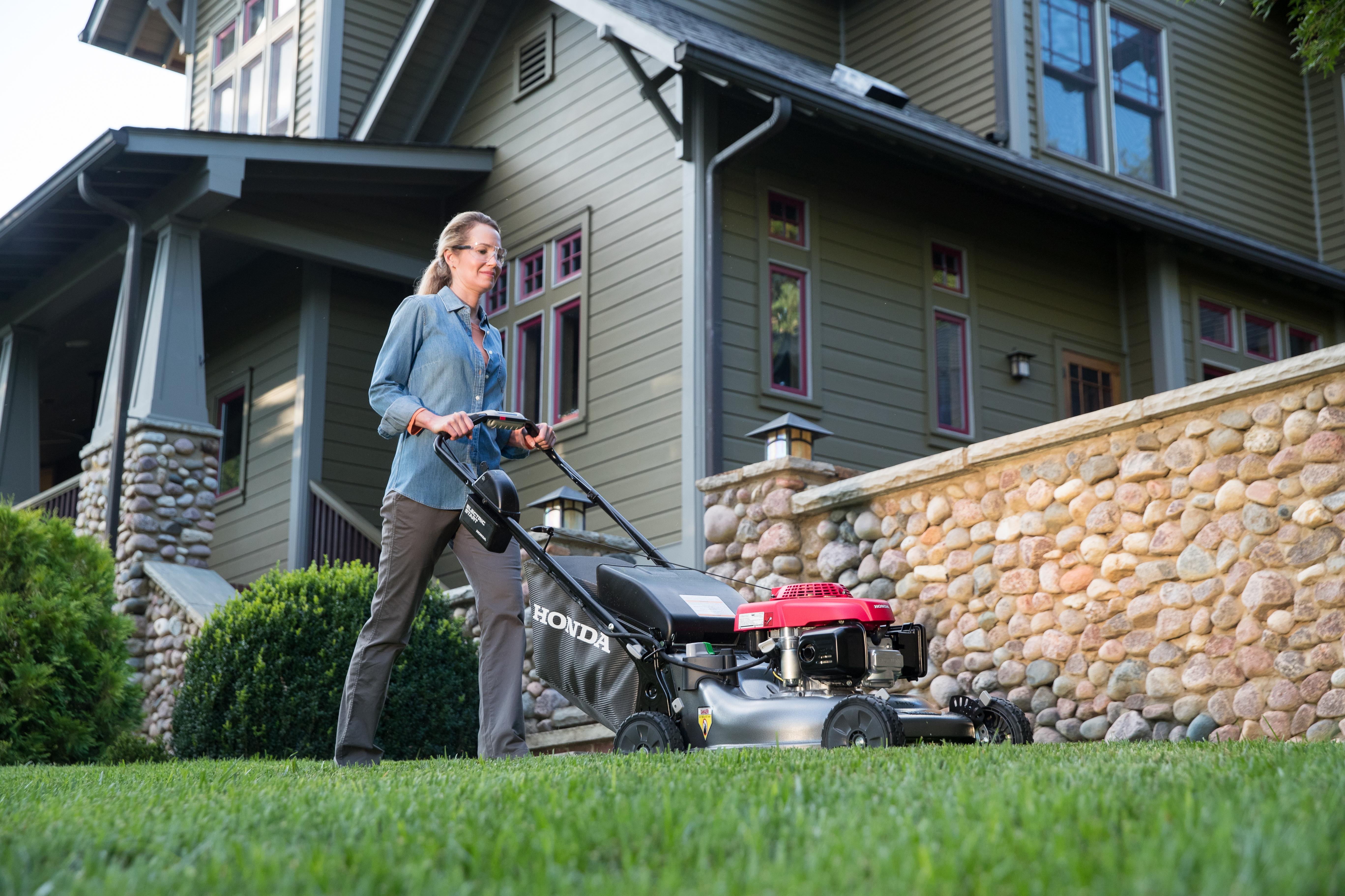 Woman Pushing Honda HRR Lawn Mower in Cumberland, MD