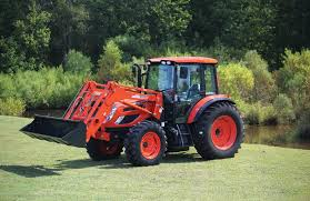 Man using Kioti tractor