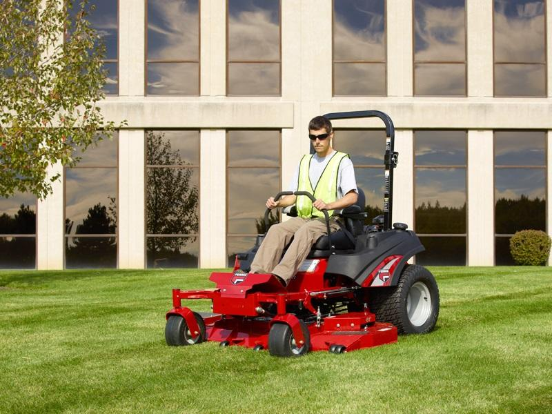 Man using a Ferris Zero Turn Mower to mow his property